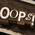 """photograph of the word """"oops!"""" spelled out in vintage letterpress"""